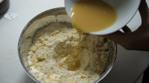 Make a well in the flour and oats and pour the maple syrup and buttermilk mixture
