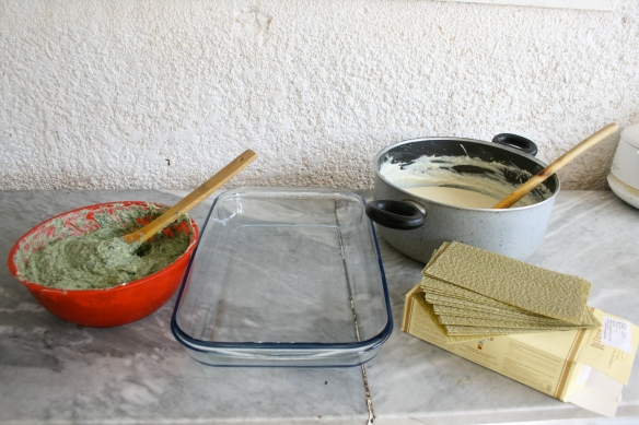 spinach and cheese filling, baking dish, bechamel sauce and sheets of dried lasagne