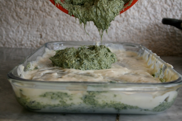 adding the spinach and cheese filling